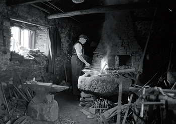 George Ellis, blacksmith in the forge